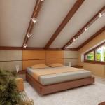 Маленькая спальня на мансарде в доме с остроскатной крышей фото